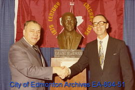 Edmonton Mayor William Hawrelak (left) shakes hands with Calgary Mayor Rod Sykes (right) at the u...