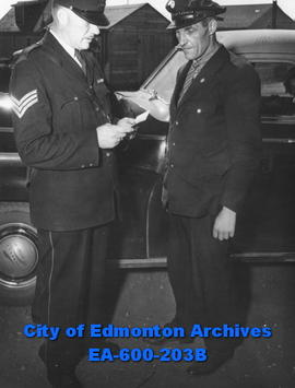 Edmonton Safety Council safety week awards: Sgt. Albert E. Woodwards inspects Englebert Sbonnel's...