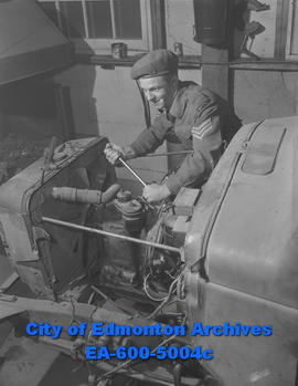 Sgt. O.R. Stevenson works on a truck used by the Royal Canadian Electrical and Mechanical Enginee...