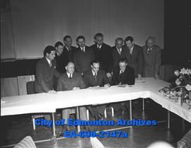 """Graphic Arts Men Form Research Branch in City"" The men in the middle are: Back Row L-R: Charles Gilbert, Allan Caldwell, Art Neale, Herb Thorneycroft. Front Row L-R: Bob Ozee, G. Lyall Roper."