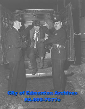 First customer for patrol wagon was quickly turned loose by by Constables Dave McIntosh and H.M. ...