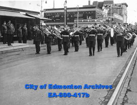 RCAF commemorates the Battle of Britain in city ceremonies: brass band passes the platform.