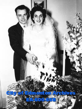Mr. and Mrs. Donald John Chute cuttting the cake at their wedding.