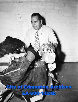 Doug Hardy, hockey coach of the Edmonton Flyers, with pads.