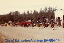 Pipes and Drums of the Edmonton Police Service marching on 1885 Street at Fort Edmonton Park