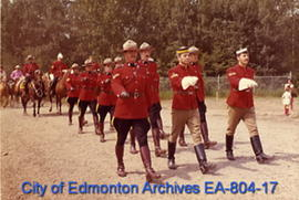 Members of the Royal Canadian Mounted Police marching on 1885 Street at Fort Edmonton Park