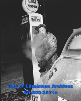 Cold weather feature: Nick Kutny gas station attendant.