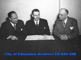 Ralph H. Johnson, middle, and William King, right, Northern Alberta Life Underwriters Association...