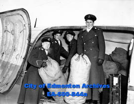 (L-R) K. E. Lewis,  W. N. Peterson, P. J. Higgs and J. R. Curry, attendees of the RCN-RCAF Colleg...