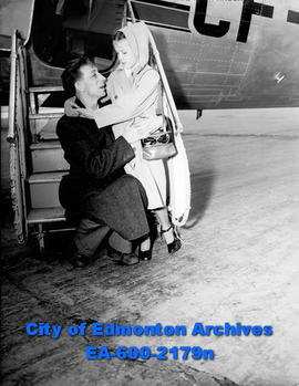 Maisie O'Driscoll says goodbye to her father at the Edmonton Airport.