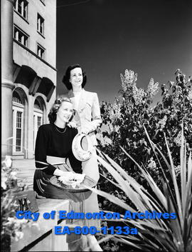 Women's Page: Mrs. K. Tuff and B. McPherson, standing on terrace at the Macdonald Hotel.