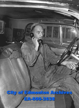 G.F. Dochterman, jack of many trades, tunes in ham radio.
