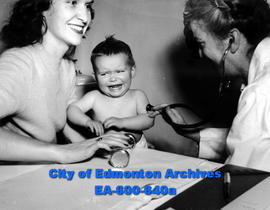 Edmonton baby clinic operated by the city board of health: Mrs. G. H. Baldwin with Dr. Frances Ne...