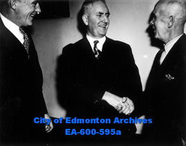 100th anniversary banquet of the founding of the Massey-Harris Company Ltd., at the Macdonald Hotel: (L-R) Bud Williamson, Mr. Justice Hugh John Macdonald and T. H. Campbell.