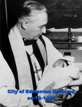 Rt. Rev. Walter F. Barfoot holding a baby Mary Margaret Apolatuk