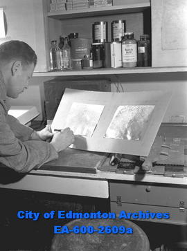 """Finger-Tips Like Face to City Print Experts"". Const. Elmer Leslie matches finger prints."