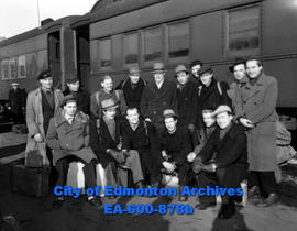 Fifteen Lett miners on CNR platform en route to Yukon silver mines. Fifth from the left in the to...