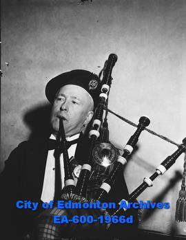 Edmonton Burns Club celebrates Robbie Burns birthday. Arthur Miller on the bagpipes.