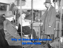 A Mack gasoline coach (bus) is demonstrated to civic officials: Thomas Ferrier, James Kerr and Ma...