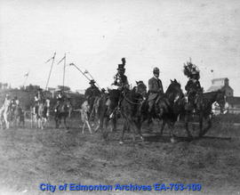 Indigenous people on horseback in a parade