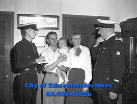 Tourist Week - L-R: Const. Fred Airth, Edmonton City Police, Mr. and Mrs. R.E. Mille with daughte...