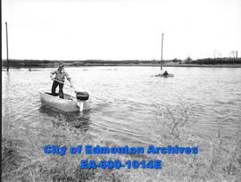 Boatbuilder Frank Barrigan in his boat and Dean Saul and Gerald LaValley in another of his boats ...