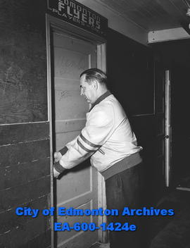 Doug Hardy, hockey coach of the Edmonton Flyers, outside locker room.