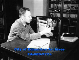 Dr. E. H. Gowan, associate professor of physics at the University of Alberta, records the amount ...