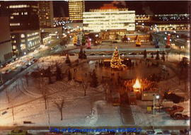 Christmas-time public event in Churchill Square looking north from the Centennial Library