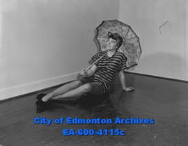 Women's Page: fashions from the past. Model Irene Greenwood in knee length bathing suit.