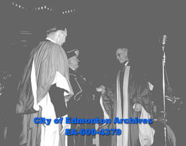 Convocation ceremonies at U of A. Premier E. Manning and Chancellor G.F. McNally present honorary...