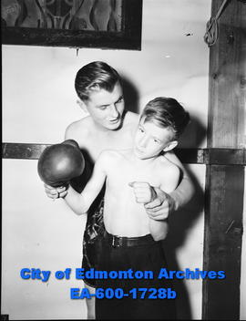 Pete Oluk gives pointers to younger boxer Al McNally.