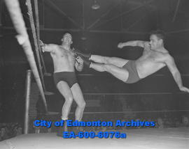 Drop-kicking Montreal villain Paul Lortie against ropes is popular grappler Steve Gob.
