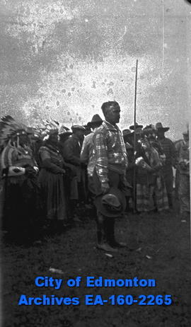 Man Standing in Front of a Crowd