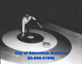 ACT Bonspiel: Ted Seney throws rock.