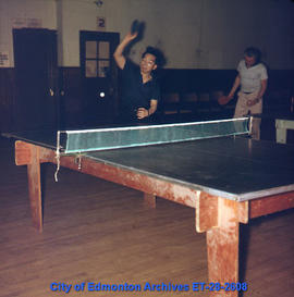 Men playing table tennis