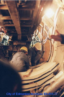 Workers in the Mill Creek sewer tunnel