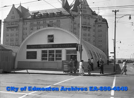 Imperial Bank of Canada in a quonset hut. Hotel Macdonald in background.