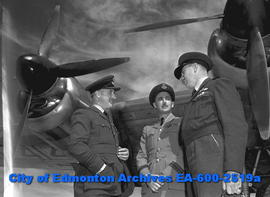 """War Time Bomber Ends Visit to City"".  L-R: Wing Commander W. Corden, Wing Commander D...."