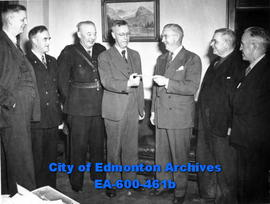 City of Edmonton employees contribute to Community Chest drive in a presentation in the office of...