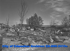 """Devastation Seen in Fire-Swept Village"". Scattered debris of village of Onoway."
