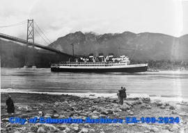 A ship passing under the Lion's Gate Bridge in Vancouver.