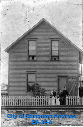 McDougall Family in Front of House