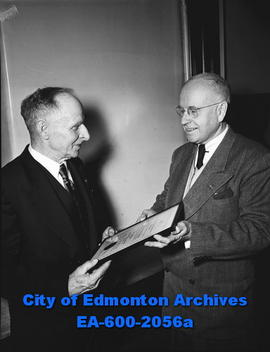 Civil Service Association presents awards. Leon F. Delany receives award from Dr. M.R. Bow.
