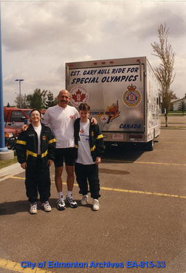 Edmonton Police Service Constable Gary Aull and Special Olympics athletes Robin Friesan (right) a...