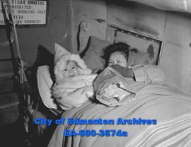 Fire victims from Dawson City. Mrs. Ellis with son Roger on plane.