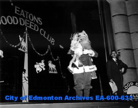 T. Eaton Co. (Western Ltd.) Good Deed Club Christmas party at the Garneau Theatre. Santa Claus is...