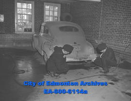 Constables Alex Osadchy and David MacIntosh examine car in which Mary Fika and Douglas Aunsley di...