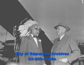 """Newfoundland Premier Joseph Smallwood under war bonnet of Plains Indian"""