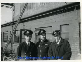 Robert and two other men in uniform